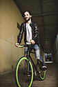 Young man riding fixie bike - RAEF001115
