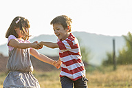 Happy little boy and girl playing together in nature - ZOCF000117