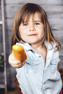 Portrait of little girl offering ice lolly - RTBF000166