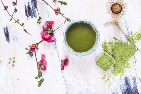 Matcha tea in bowl, with match powder, spoon and chasen and pink flowers - SBDF002862