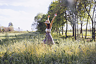 Happy young woman on a meadow in spring - GIOF000919
