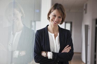 Portrait of confident businesswoman - RBF004440