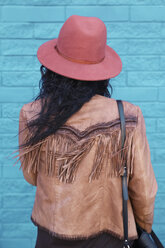 Back view of woman with blowing hair - RTBF000172