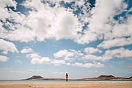 Lanzarote, Rear view of nude man standing on Playa del risco - WV000772