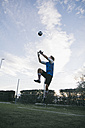 Goalkeeper trying to catch football - ABZF000471