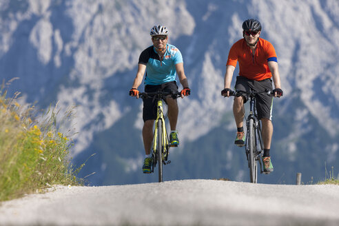 Two men on a bicycle tour with trekking bikes - DSF000665