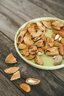 Almonds, green plate on wood - JPF000139