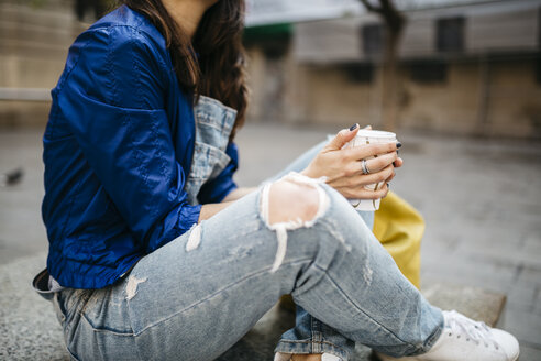Young woman with a coffee in the city - JRFF000612