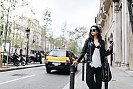 Spain, Barcelona, young woman in the city - JRFF000621