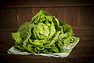 Butterhead lettuce on kitchen towel - MAEF011487
