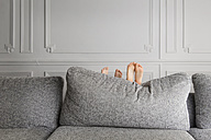 Feet of two little children hiding behind the couch - LITF000292