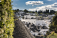 Italy, Apulia, Alberobello, Trulli, dry stone huts with conical roofs - CSTF001061