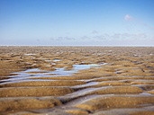 Germany, Lower Saxony, Cuxhaven, Wadden Sea during low tide - KRPF001740