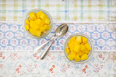 Two glasses of overnight oats with diced mango - LVF004855