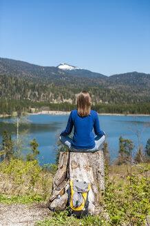 Germany, Bavaria, woman relaxing at lake Barmsee - DIGF000471