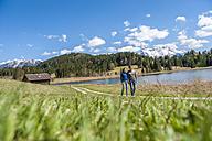 Germany, Bavaria, couple walking at lake Barmsee - DIGF000477
