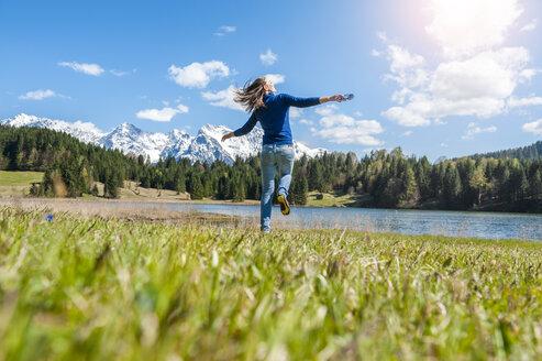 Germany, Bavaria, carefree woman at lake Barmsee - DIGF000483