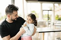 Man playing with his little daughter - JASF000723