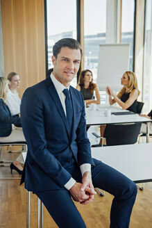 Portrait of confident businessman in a meeting - CHAF001709