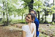 Portrait of happy woman with her boyfriend in nature - GIOF000965