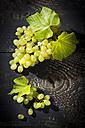 Green grapes on dark wood - MAEF011702