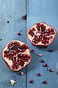 Sliced pomegranate on blue wood - RTBF000195
