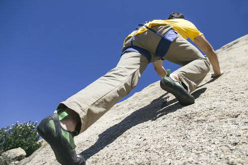Man climbing in a granite wall - ABZF000503