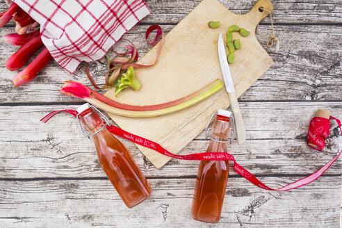 Two glass bottles of homemade rhubarb juice - LVF004887