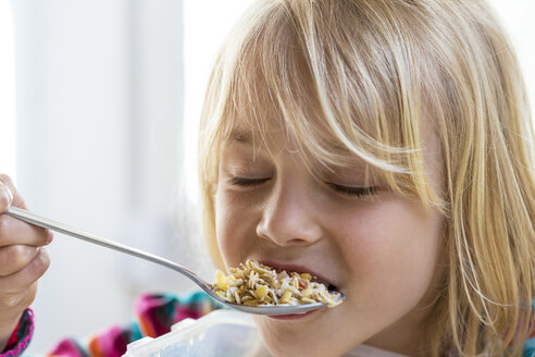 Portrait of little girl eating granola - JFEF000792