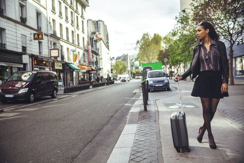 France, Paris, young woman waiting for a taxi - ZEDF000122