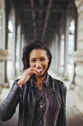 France, Paris, portrait of smiling young woman - ZEDF000131
