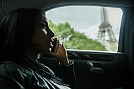 France, Paris, young woman telephoning in a car - ZEDF000137