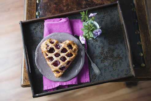 Heart-shaped cherry cake and flowers on tray - MYF001477