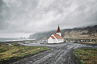 Iceland, Vik, view to village and church, dramatic sky - ASCF000583
