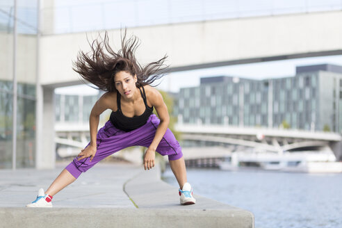 Young woman exercising at riverside - ASCF000590