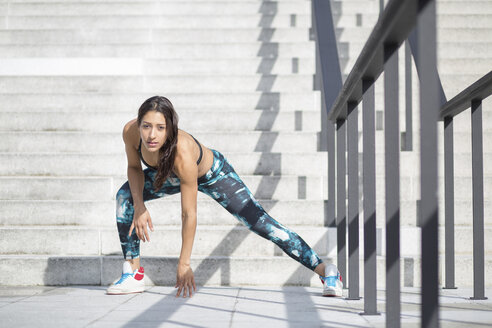 Young woman exercising at stairs - ASCF000596
