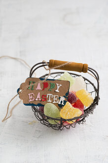 Happy Easter tag on basket with jelly eggs - MYF001483