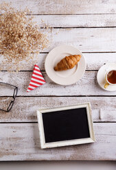 Table with croissant, tea and black board with copy space - HAPF000353