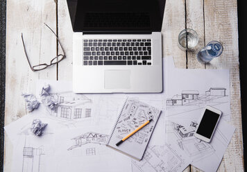 Desk of an architect with laptop and sketches - HAPF000374