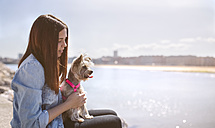 Young woman with her Yorkshire Terrier - MGOF001847