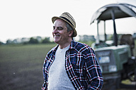 Portrait of smiling farmer in front of a field - UUF007336