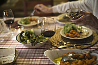 Laid table for dinner with red wine - RIBF000408