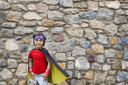 Little big hero with a mask against a stone wall - VABF000491
