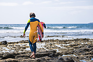 Spain, Tenerife, young surfer with surfboard - SIPF000499