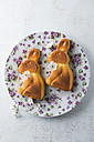Two cakes shaped like Easter bunnies on a dish - MYF001491