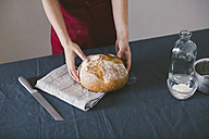 Woman holding hand made bread - EBSF001392