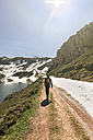 Spain, Asturias, Somiedo, man hiking in mountains - MGOF001855