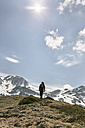 Spain, Asturias, Somiedo, man hiking in mountains - MGOF001858