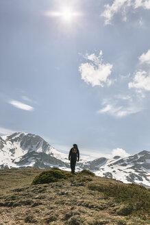 Spain, Asturias, Somiedo, man hiking in mountains - MGOF001858