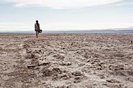 Chile, San Pedro de Atacama, woman walking in the desert - MAUF000607
